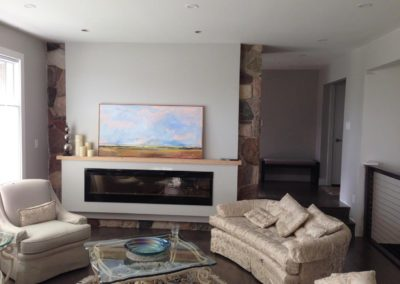Fireplace partially covered with drywall